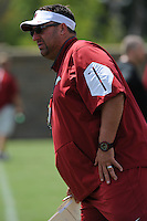 NWA Democrat-Gazette/ANDY SHUPE<br /> Arkansas coach Bret Bielema watches Tuesday, Aug. 11, 2015, during practice at the university's practice field in Fayetteville.
