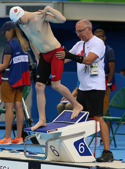 Rio de Janeiro-9/9/2016- Nathan Clement competes in the men's 50m butterfly during the swimming  at the 2016 Paralympic Games in Rio. Head coach Craig McCord assists Nathan Clement. Photo Scott Grant/Canadian Paralympic Committee