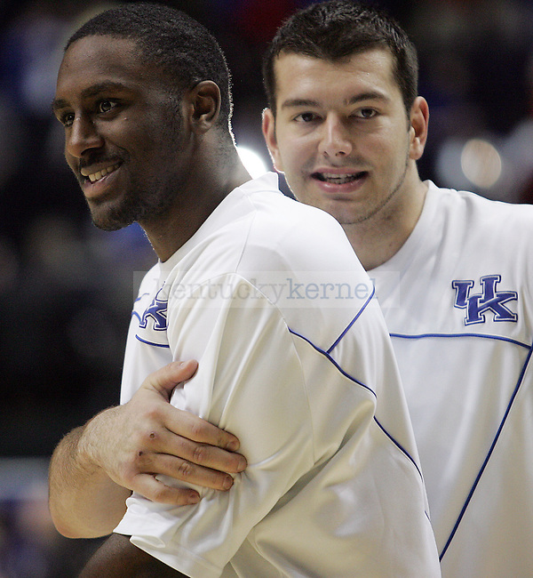 Josh Harrellson hugs Patrick Patterson before the UK mens basketball team's 73-67 win over Alabama in the quarterfinals of the SEC tournament at the Sommet Center Friday, March 12, 2010. Photo by Britney McIntosh | Staff