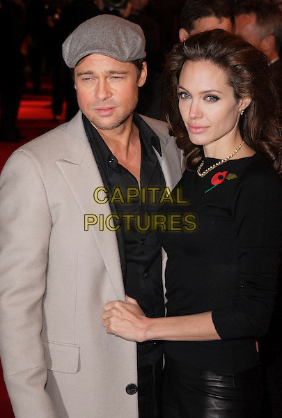 "BRAD PITT & ANGELINA JOLIE.European Premiere of ""Beowulf"" at the Vue West End, Leicester Square, London, England, November 11th 2007..half length grey hat cap jacket coat black shirt top poppy couple .CAP/ROS.©Steve Ross/Capital Pictures"