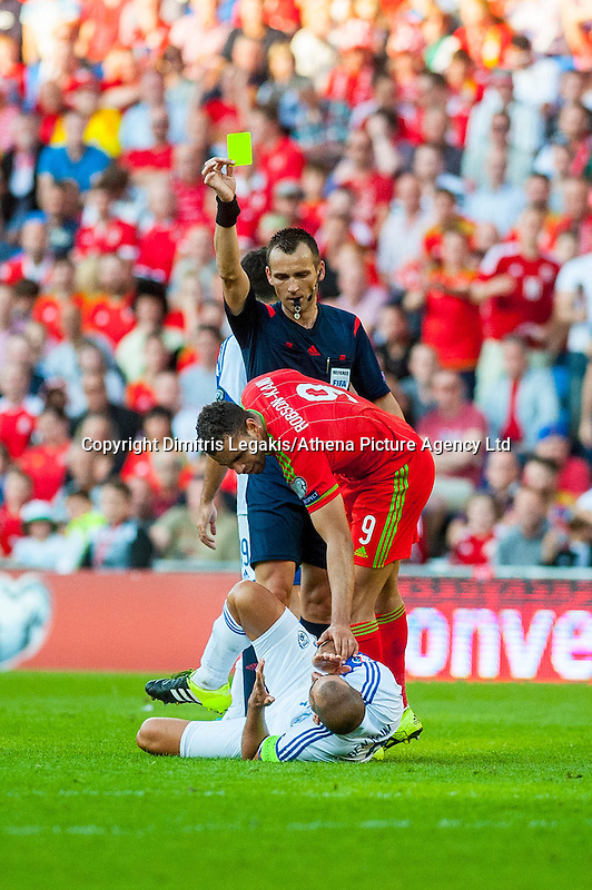Hal Robson-Kanu of Wales  receives a yellow card from Referee Ivan Bebek during their UEFA EURO 2016 Group B qualifying round match held at Cardiff City Stadium, Cardiff, Wales, 06 September 2015. EPA/DIMITRIS LEGAKIS