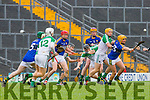 Kerry's John Griffin reaches for the runaway ball wihilsty being pulled back by  Limerick's Paul Browne  during their NHL Div 1B clash in Fitzgerald Stadium on Sunday
