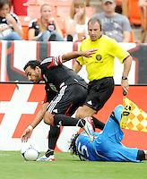 D.C. United forward Dwayne De Rosario (7)goes against Philadelphia Union defender Gabriel Farfan (15) D.C. United tied The Philadelphia Union 1-1 at RFK Stadium, Saturday August 19, 2012.