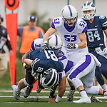 8 October 2016: Amherst College Purple & White Offensive Linebacker Parker Chapman, a Senior from St. Paul, MN, assists on bringing down Middlebury College Panther Wide Receiver James Burke, a Senior from West Barnstable, MA, at Alumni Stadium in Middlebury, Vermont. The Panthers edged out the Purple & While 27-26. Mandatory Credit: Ed Wolfstein Photo *** RAW (NEF) Image File Available ***