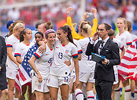 LYON,  - JULY 7: Megan Rapinoe #15 talks with Alex Morgan #13 during a game between Netherlands and USWNT at Stade de Lyon on July 7, 2019 in Lyon, France.
