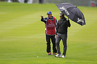 Ricardo Gouveia (POR) and caddy Nick Mumford on the 9th hole during a wet Saturday's Round 3 of the 2017 Omega European Masters held at Golf Club Crans-Sur-Sierre, Crans Montana, Switzerland. 9th September 2017.<br /> Picture: Eoin Clarke | Golffile<br /> <br /> <br /> All photos usage must carry mandatory copyright credit (&copy; Golffile | Eoin Clarke)