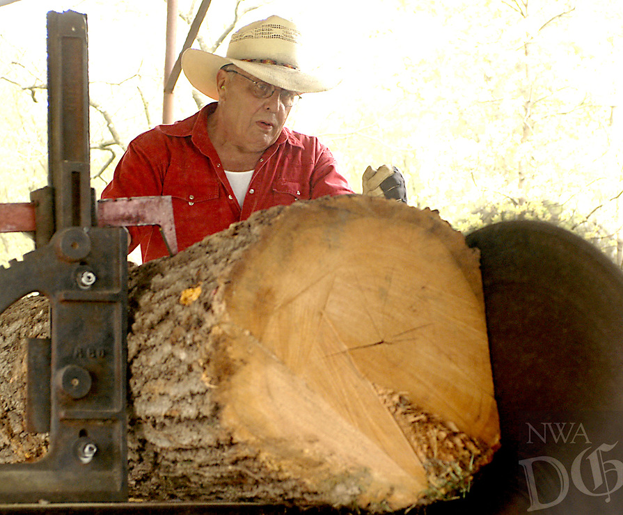 Photo by Randy Moll<br /> Jamie Smilie of Inola, Okla., demonstrates cutting logs down to boards and timbers at the Tired Iron of the Ozarks saw mill on Friday (April 14, 2017) at the club's Gentry showgrounds.
