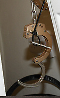 """Pictured: The handcuffs used to keep the victim chained to a radiator.<br /> Re: Two men who handcuffed another to a radiator for over 24hrs have are due to be sentenced by Cardiff Crown Court, Wales, UK.<br /> Peter Shodeinde and Sochi Ezeemo, both 27, collected the man from Bristol and brought him to a house in Treforest. <br /> Ezeemo contacted the brother of the victim in Nigeria demanding money they said was owed to them. Police in the UK were contacted by the victim's brother telling them about the demands. <br /> When police raided the house where they believed the victim was being held prisoner, they found him injured and handcuffed to a radiator.  <br /> Shodeinde claimed that he was part not of the kidnapping and false imprisonment but evidence presented by the CPS was able to prove that he was. <br /> Kelly Huggins, of the CPS, said: """"The victim suffered appalling treatment whilst being kept prisoner, being beaten, deprived of sleep and enduring acts of humiliation such as shaving off his hair.<br /> """"It is difficult to imagine how frightening this horrible experience would have been for the victim.<br /> """"Now that the case has concluded, we hope it will help him move forward in his healing process."""""""