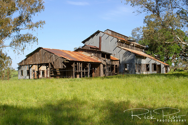 The machine shop is one of the last remaining structures of the La Grange Gold Mining Camp. Located in California's gold country, near the town of La Grange, the camp supported a gold dredge operation responsible for taking millions of dollars worth of gold from the Tuolomne River. The camp was abandoned in 1959 when the price of gold no longer supported the dredging operation. Photographed 04/05