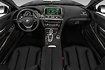 Stock photo of straight dashboard view of 2016 BMW 6 Series 640i Black Accent Pkg 2 Door Convertible Dashboard
