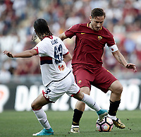 Calcio, Serie A: Roma, stadio Olimpico, 28 maggio 2017.<br /> AS Roma's Francesco Totti (r) in action with Genoa's Diego Laxalt  (l) during the Italian Serie A football match between AS Roma and Genoa at Rome's Olympic stadium, May 28, 2017.<br /> Francesco Totti's final match with Roma after a 25-season career with his hometown club.<br /> UPDATE IMAGES PRESS/Isabella Bonotto