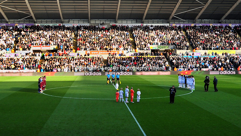 NO BYLINE PLEASE<br /> Pictured: Aston Villa and Swansea players observe a minute's silence  before kick off in memory of Wales football manager Gary Speed who has died. Sunday 27 November 2011<br /> Re: Premier League football Swansea City FC v Aston Villa at the Liberty Stadium, south Wales.