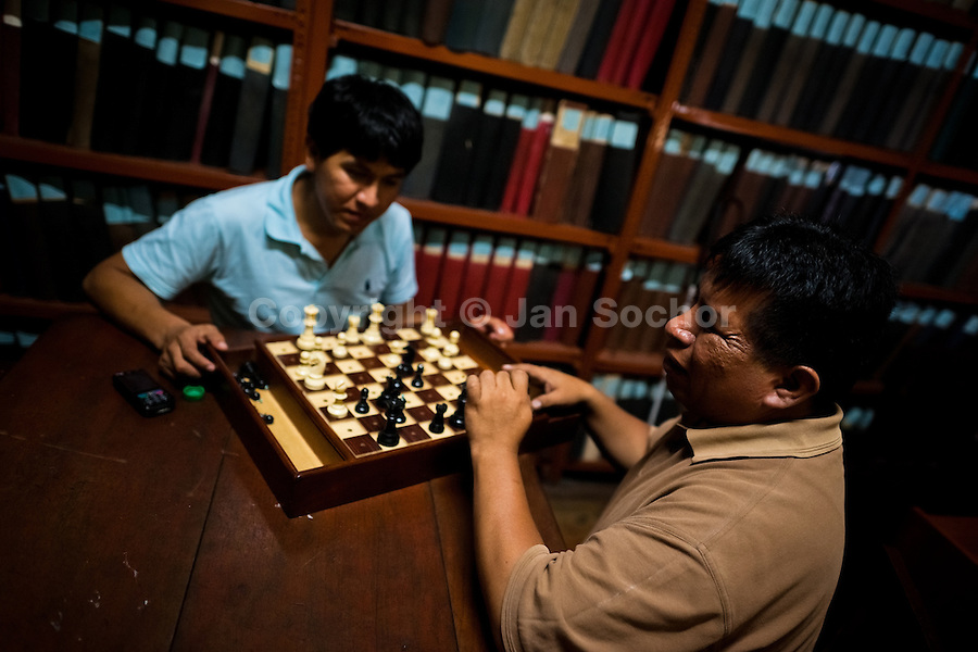 Blind men play chess in the library of Unión Nacional de Ciegos del Perú, a social club for the visually impaired in Lima, Peru, 3 April 2013. Unión Nacional de Ciegos del Perú, one of the first societies for disabled in Latin America, was established in 1931 to provide a daily service for blind and partially sighted people from the capital city. The range of activities includes reading books in a large Braille library, playing chess or using a computer adapted for visually impaired individuals. As the majority of the blind does not have a regular job, the UNCP club offers them an opportunity to learn and lately, to provide massages to the club visitors and thus generate some income.