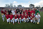 Homeplayers posing for a team photograph at Broadhurst Park, Manchester, the new home of FC United of Manchester before the club's match against Benfica, champions of Portugal, which marked the official opening of their new stadium. FC United Manchester were formed in 2005 by fans disillusioned by the takeover of Manchester United by the Glazer family from America. The club gained several promotions and played in National League North in the 2015-16 season, but lost this match 1-0.