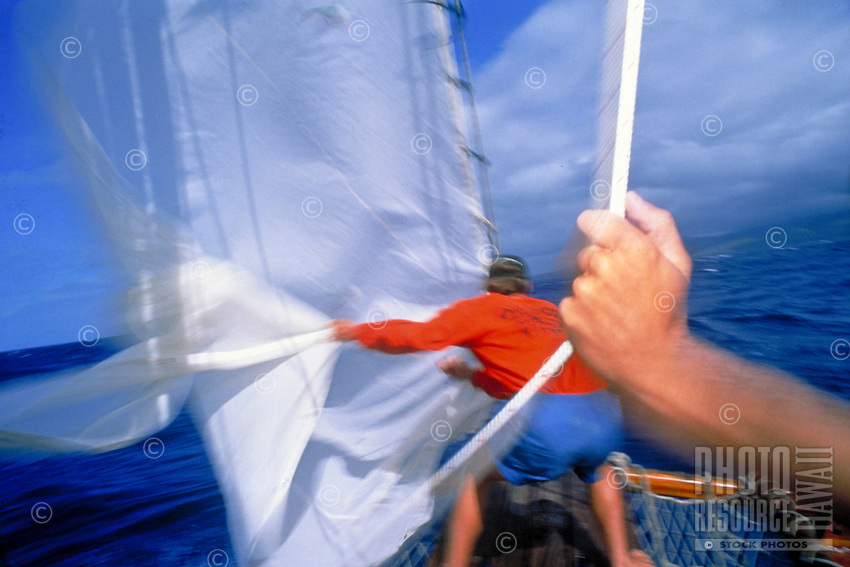 Sailing, pulling the jib out at sea.