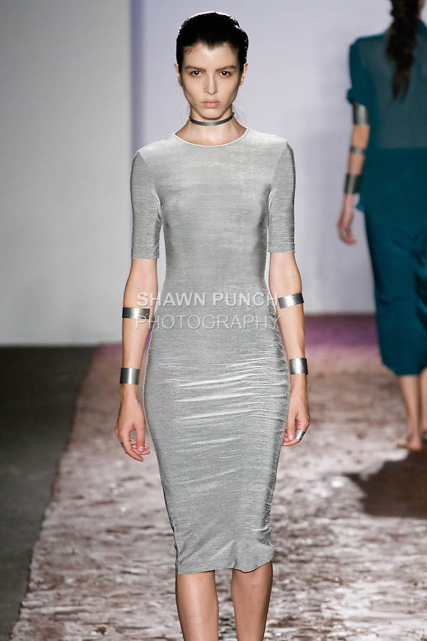 Model walks runway in an oxide silver kanjor noverlty ponte dress from the Kimberly Ovitz Spring 2013 runway show at Pier 57, during New York Fashion Week on September 6, 2012.