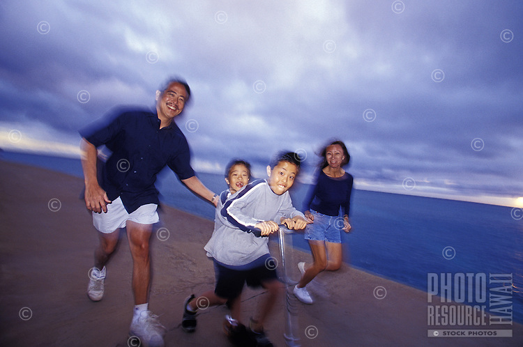 Local Hawaiian family playing in Ala Moana's Magic Island Park, Honolul/Waikiki, Oahu, Hawaii