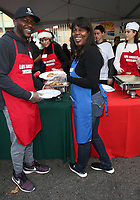 21 December 2018 - Los Angeles, California - Edwin Hodge, Yolette Richardson. Los Angeles Mission Christmas Meal for the Homeless held at Los Angeles Mission. Photo Credit: F. Sadou/AdMedia