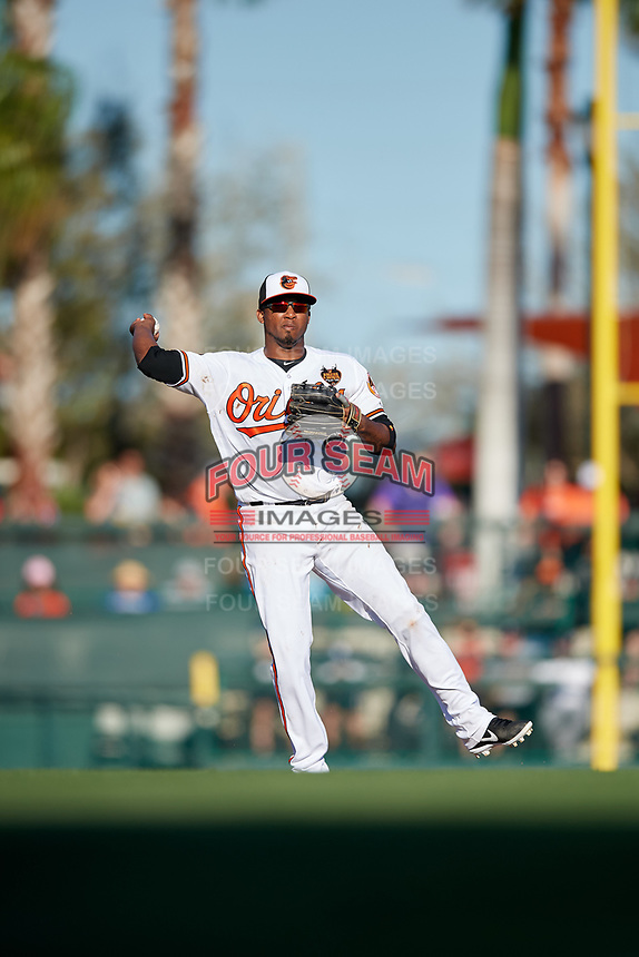 Baltimore Orioles shortstop Alcides Escobar (1) throws to first base during a Grapefruit League Spring Training game against the Detroit Tigers on March 3, 2019 at Ed Smith Stadium in Sarasota, Florida.  Baltimore defeated Detroit 7-5.  (Mike Janes/Four Seam Images)