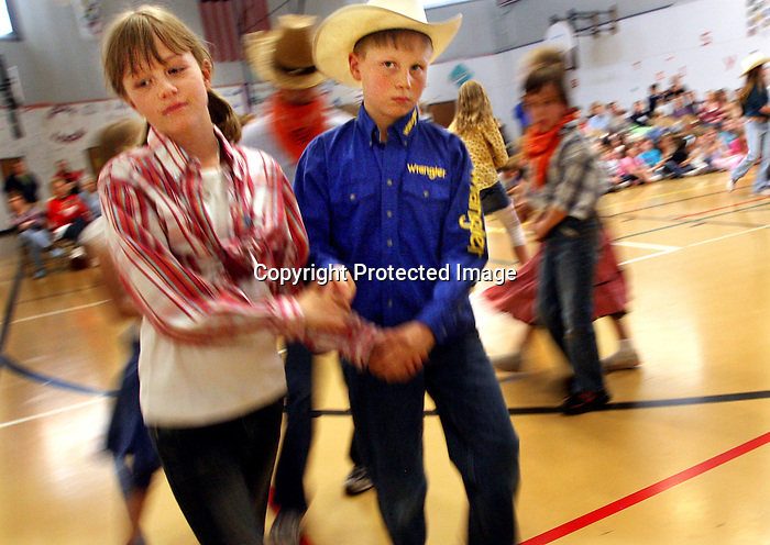 MICHAEL SMITH/WTE.Anderson Elementary fourth graders Tamara Sieben, 10, and Logan Potter, 10, perform during a square dance program at the school Thursday afternoon.  Anderson teacher Fiona Von Krosigk said during an introduction before the program that one of the hardest parts of teaching the students is not the elaborate dance steps but getting the kids to hold hands with the opposite gender.