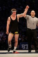 STATE COLLEGE, PA - FEBRUARY 8: Sammy Brooks of the Iowa Hawkeyes gets his hand raised after defeating Matt McCutcheon of the Penn State Nittany Lions after their match on February 8, 2015 at the Bryce Jordan Center on the campus of Penn State University in State College, Pennsylvania. The Hawkeyes won 18-12. (Photo by Hunter Martin/Getty Images) *** Local Caption *** Sammy Brooks