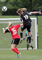 BOYDS, MARYLAND - July 21, 2012:  Ashley Herndon (15) of DC United Women heads away from Megan Weston (16) of the Virginia Beach Piranhas during a W League Eastern Conference Championship semi final match at Maryland Soccerplex, in Boyds, Maryland on July 21. DC United Women won 3-0.