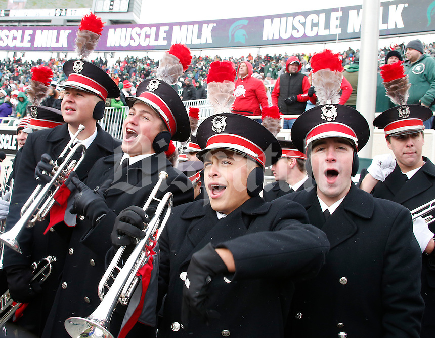 Members of the Ohio State University marching band celebrate near the end of during Saturday's NCAA Division I football game at Spartan Stadium in East Lansing, Mich., on November 19, 2016. Ohio State won the game 17-16. (Barbara J. Perenic/The Columbus Dispatch)
