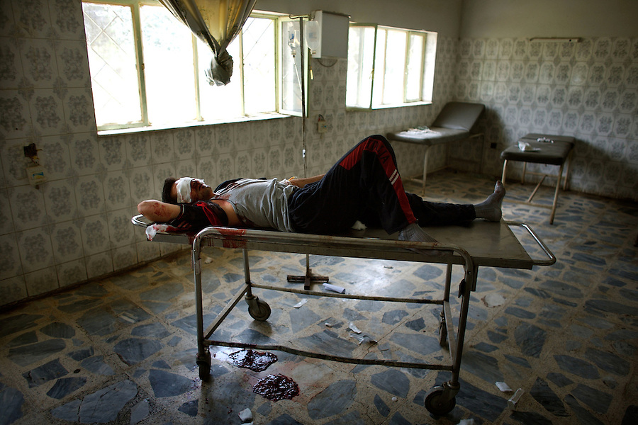 An Iraqi man lies unattended in  the emergency room at Baqubah General Hospital bleeding from cuts to his face and head after being struck by shrapnel on Friday June 1, 2007.
