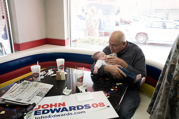 January 24, 2008. Laurens, SC.. Presidential candidate and former US senator, John Edwards campaigned across the western part of South Carolina today in an effort to shore up support before Saturday's primary election.. Frank Leroy gives a bottle to his granddaughter, Natalie Crawford, at the Giant Burger in Laurens, SC.