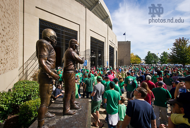 Sept. 28, 2013; Fans enter Notre Dame Stadium through the Lou Holtz gate past the eponymous statue.<br />