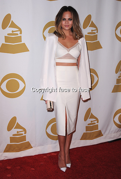 LOS ANGELES, CA - JANUARY 27:  Chrissy Teigen arrives at &quot;The Night That Changed America: A Grammy Salute to The Beatles&quot; at the Los Angeles Convention Center West Hall on January 27, 2014 in Los Angeles, California. <br />