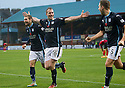 Dundee's David Clarkson (16) celebrates with Martin Boyle (23) and Greg Stewart (15) after he scores.