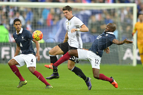 13.11.2015. Stade de France, Paris, France. International football friendly. France versus Germany.  Mario GOMEZ - RAPHAEL VARANE - LASSANA DIARRA . The game was parially interupted as the paris terror attacks took place and bombs were heard going off outside the stadium.