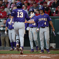 NWA Democrat-Gazette/ANDY SHUPE<br /> LSU catcher Saul Garza (13) is congratulated Friday, May 10, 2019, by shortstop Josh Smith after hitting a 2-run home run during the second inning against Arkansas at Baum-Walker Stadium in Fayetteville. Visit nwadg.com/photos to see more photographs from the game.