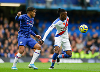 9th November 2019; Stamford Bridge, London, England; English Premier League Football, Chelsea versus Crystal Palace; Reece James of Chelsea covers Wilfried Zaha of Crystal Palace - Strictly Editorial Use Only. No use with unauthorized audio, video, data, fixture lists, club/league logos or 'live' services. Online in-match use limited to 120 images, no video emulation. No use in betting, games or single club/league/player publications