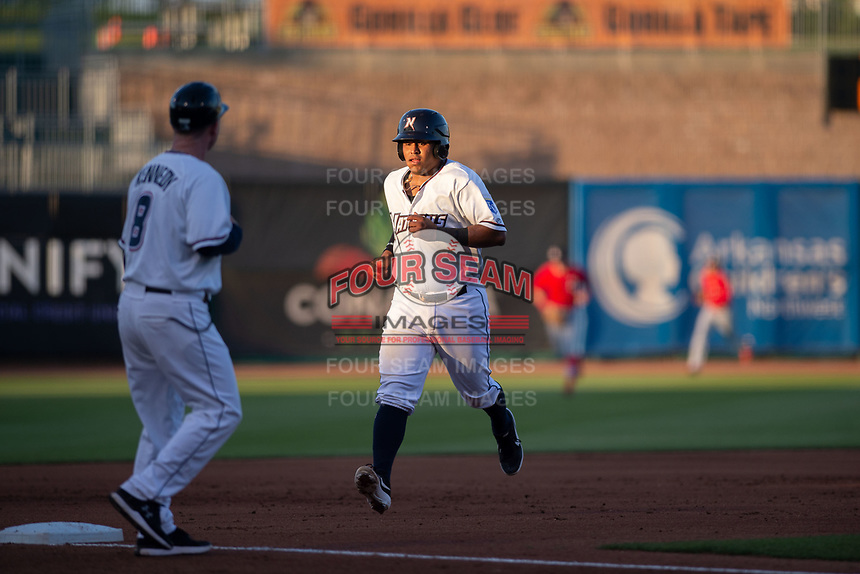 Northwest Arkansas Naturals catcher Meibrys Viloria (22) jogs to third on May 16, 2019, at Arvest Ballpark in Springdale, Arkansas. (Jason Ivester/Four Seam Images)