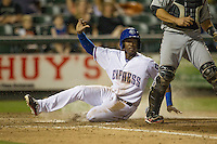 Round Rock second baseman Jurickson Profar (10) slides across home plate in the Pacific Coast League baseball game against the Nashville Sounds on May 4, 2013 at the Dell Diamond in Round Rock, Texas. Round Rock defeated Nashville -6. (Andrew Woolley/Four Seam Images).