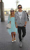 Paris Hilton and River Viiperi at Los Angeles International Airport