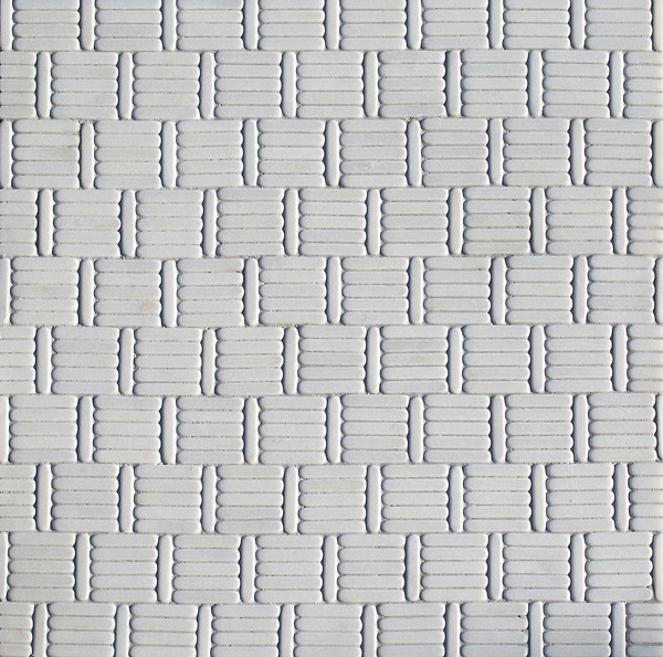 Wicker, a hand-cut tumbled mosaic, shown in Afyon White, is part of the Tissé® collection for New Ravenna.