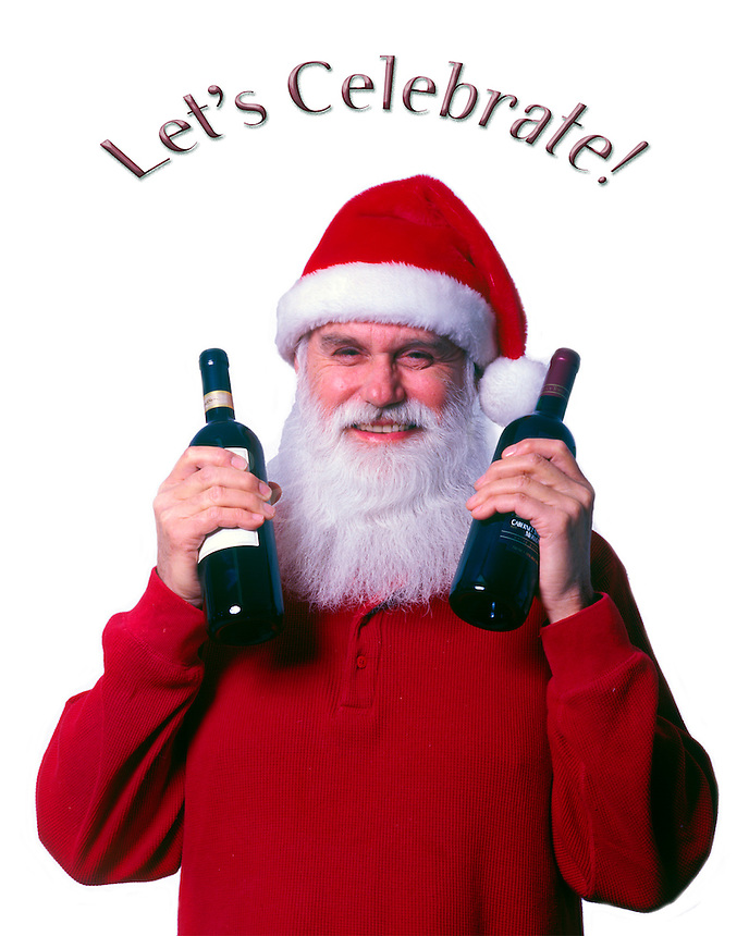 Santa holds two bottles of wine in a gesture of generosity and celebration.  Model Release.
