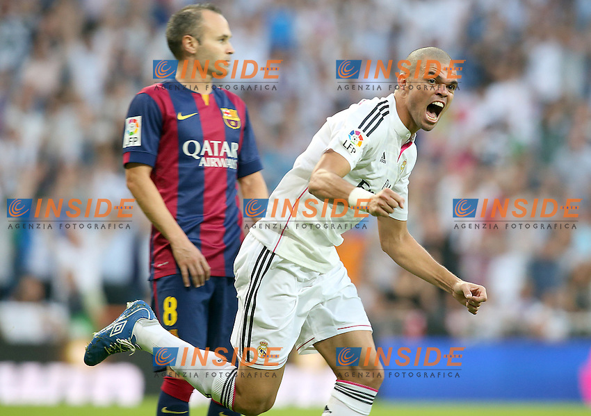 Real Madrid's Pepe (r) celebrates goal in presence of FC Barcelona's Andres Iniesta during La Liga match.October 25,2014. (ALTERPHOTOS/Acero) <br /> Clasico<br /> Foto Insidefoto