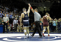 STATE COLLEGE, PA - JANUARY 25: Logan Storley of the Minnesota Golden Gophers walks off the mat after being defeated by Matt Brown of the Penn State Nittany Lions during their match on January 25, 2015 at Recreation Hall on the campus of Penn State University in State College, Pennsylvania. Minnesota won 17-16. (Photo by Hunter Martin/Getty Images) *** Local Caption *** Matt Brown;Logan Storley