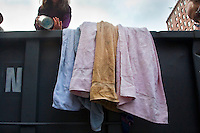Many reusable products, such as towels and food, are recovered from a dumpster outside New York University (NYU) after the students have moved out of the dorms for the summer.