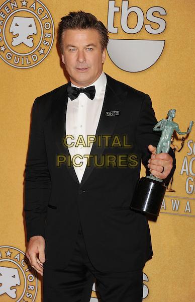 Alec Baldwin.The 18th Annual Screen Actors Guild Awards held at The Shrine Auditorium in Los Angeles, California, USA..January 29th, 2012.SAG SAGS half length black tuxedo white shirt bow tie award trophy winner  .CAP/ROT/TM.©Tony Michaels/Roth Stock/Capital Pictures