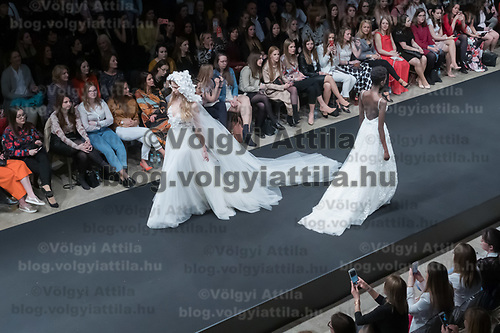 Models present creations from the Rebelle collection of designer Anita Benes of the Daalarna brand during a fashion show in Budapest, Hungary on April 12, 2019. ATTILA VOLGYI