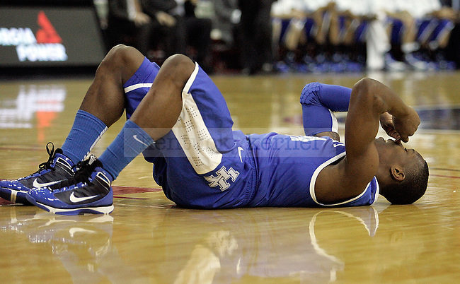 Freshman guard Eric Bledsoe lies on the floor in frustration after falling down during an attempted shot in the first half of UK's win over Georgia at Stegeman Coliseum  in Athens, GA on Wednesday, March 3, 2010. Photo by Britney McIntosh | Staff