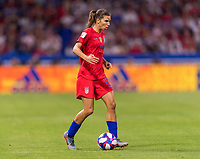 LYON,  - JULY 2: Tobin Heath #17 dribbles during a game between England and USWNT at Stade de Lyon on July 2, 2019 in Lyon, France.