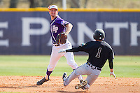 High Point Panthers shortstop Tony Fortier-Bensen (8) turns a double play as Michael Paez (1) of the Coastal Carolina Chanticleers slides into second base at Willard Stadium on March 15, 2014 in High Point, North Carolina.  The Chanticleers defeated the Panthers 1-0 in game one of a double-header.  (Brian Westerholt/Four Seam Images)