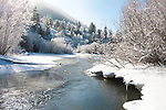 Flat Creek flows between ice covered banks in the town of Jackson, Wyoming.