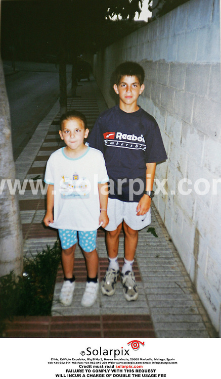 EXCLUSIVE PICTURES FROM SOLARPIX.COM.MUST CREDIT SOLARPIX.COM OR DOUBLE FEE INCURRED.The arsenal football player Francesc fabregas shown here with his family his farther by the same name and his sister Carlota and his cousins, there is the only picture of Francesc Fabregas and his girlfriend Carla DoÐa at a water park near Barcelona she is pictured far right with Fabregas and his farther and sister accompanied by a hippopotamus in pink..This picture shows:Fabregas and his sister Carlota..DATE:31.03.06-JOB REF:2220-MER